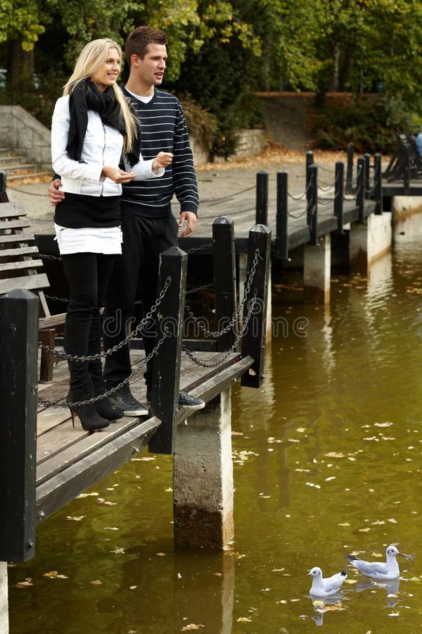 Download Young Couple By Autumn Lake Stock Image - Image: 25428649