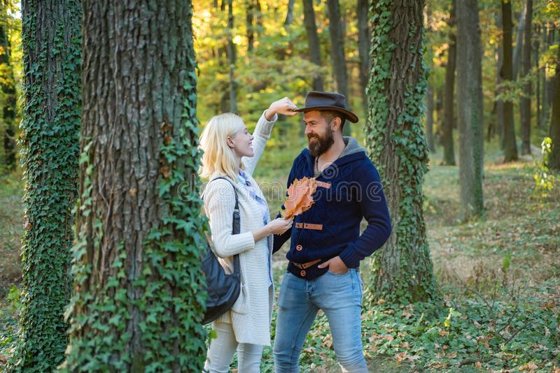 Young couple with autumnal mood. Passion dating and love. Autumn and leaf fall Dreams. Portrait of beautiful woman and. Young couple with autumnal mood. Passion stock photos