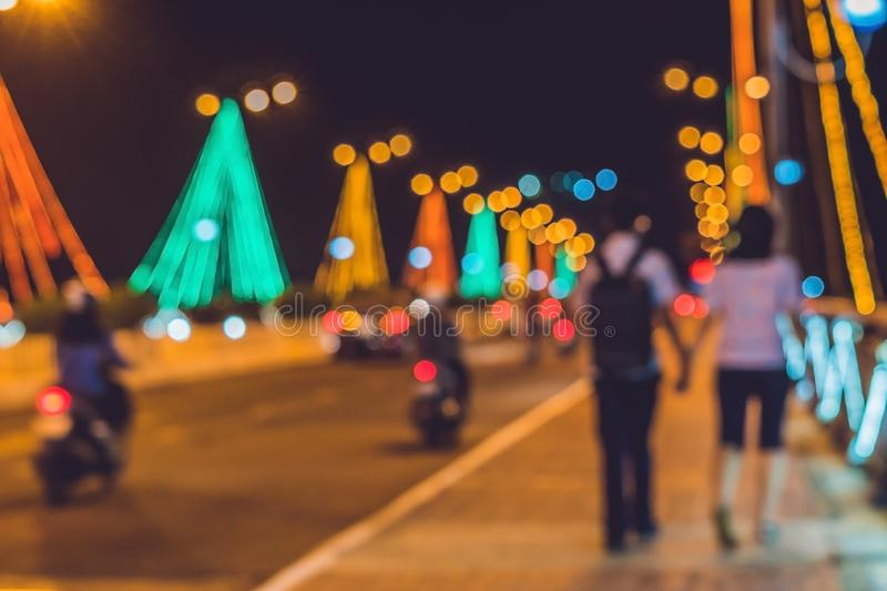 Young couple on the background. Busy traffic on a bridge at night. Blurred focus stock images