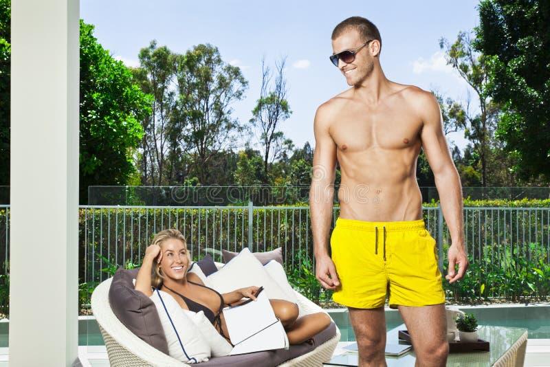 Download Young couple in backyard stock image. Image of bikini - 23851107