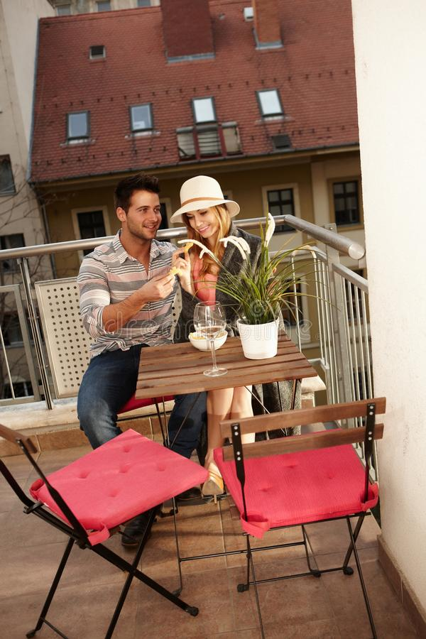 Young couple on balcony royalty free stock image