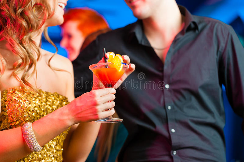 Download Young Couple In Bar Or Club Drinking Cocktails Stock Photography - Image: 35771492