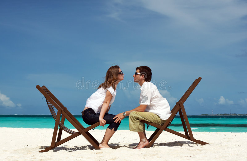 Young couple on the beach royalty free stock image