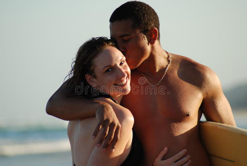Young couple on the beach royalty free stock photos