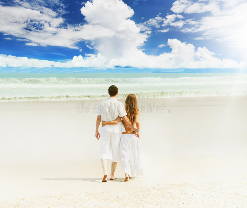 Young couple on a beach. Young beautiful couple on a sunny beach royalty free stock photos