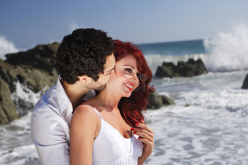 Young Couple At The Beach Showing Affection Stock Photo