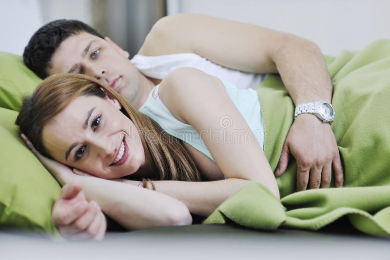 Download Young couple in bed stock photo. Image of love, awake - 13772056