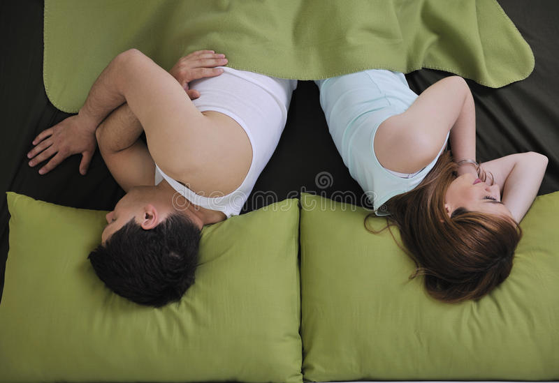 Young Couple In Bed Stock Photo