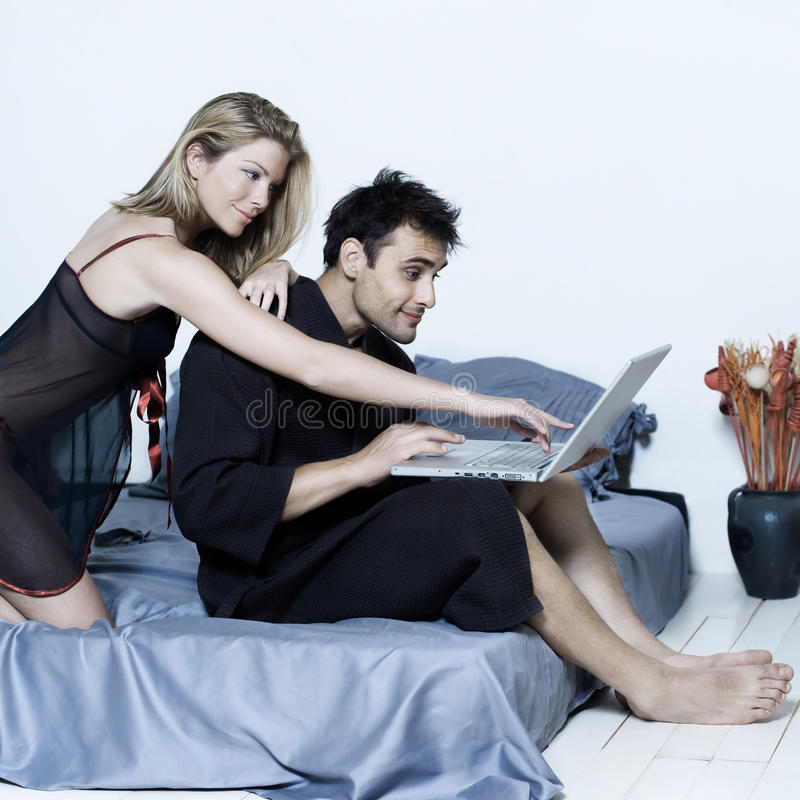 Young couple in a bed stock photography