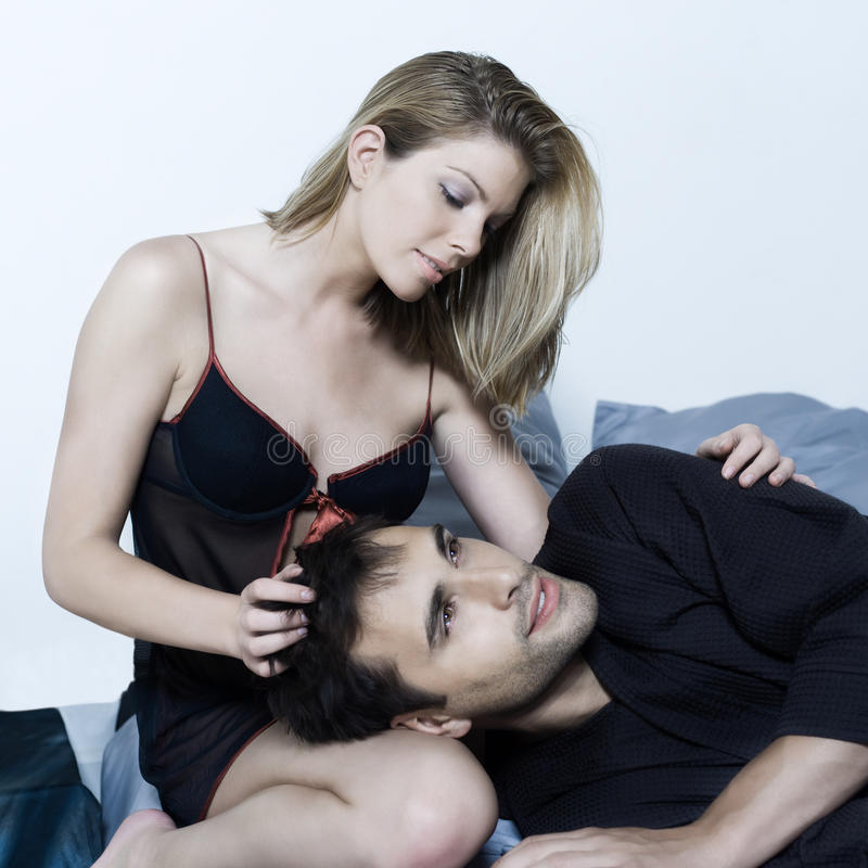 Young couple in a bed stock photo