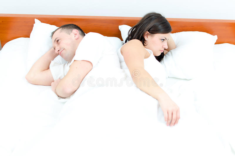 A young couple in bed. Having problems royalty free stock photo