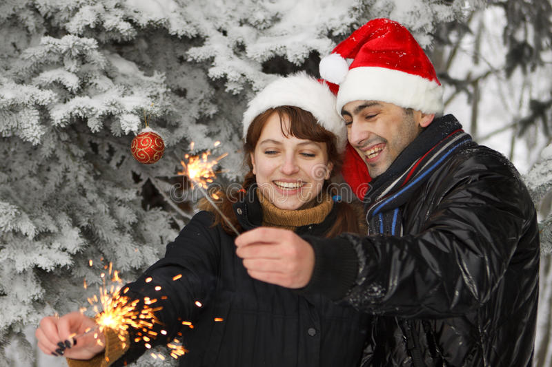 Young couple with bengal firework stock photography
