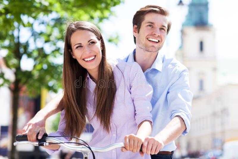 Young couple on bike stock image