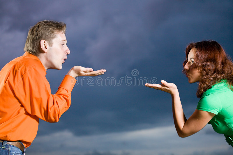 Young couple blowing a kisses stock photo
