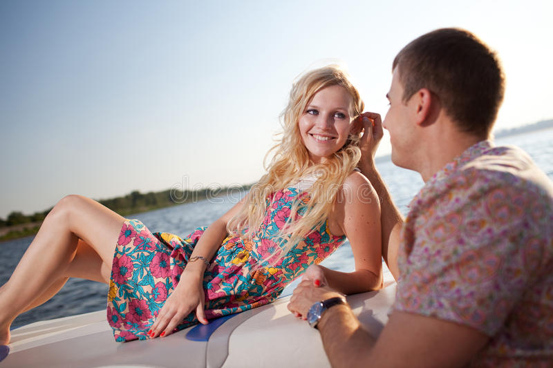 Young couple on the boat royalty free stock photos