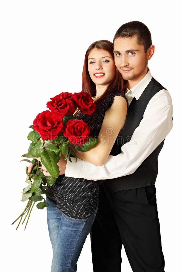 Young Couple With Bouquet Royalty Free Stock Photos