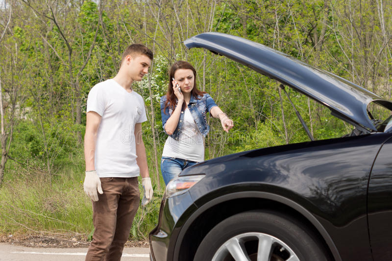 Young Couple Broken Down Side Road Photos - Free & Royalty-Free Stock  Photos from Dreamstime