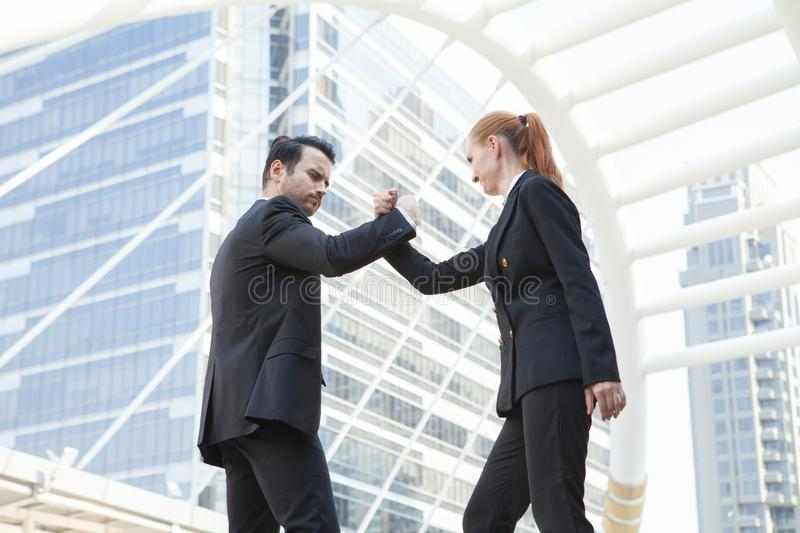 Young couple business people fighting for successful of business. Fighting concept stock images