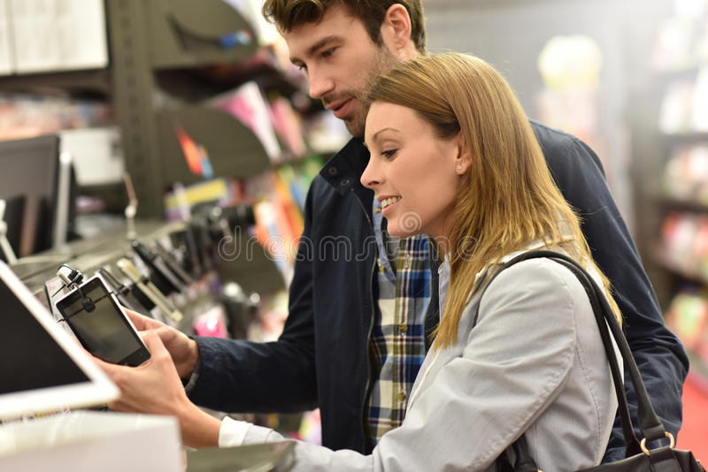 Young couple buying smartphone stock photography