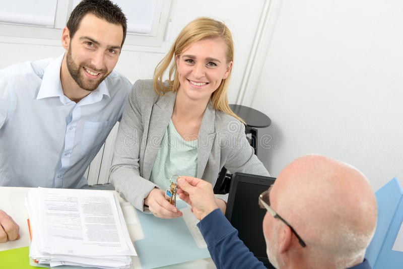 Young couple buys a house. A young smiling couple buys an apartment royalty free stock photography