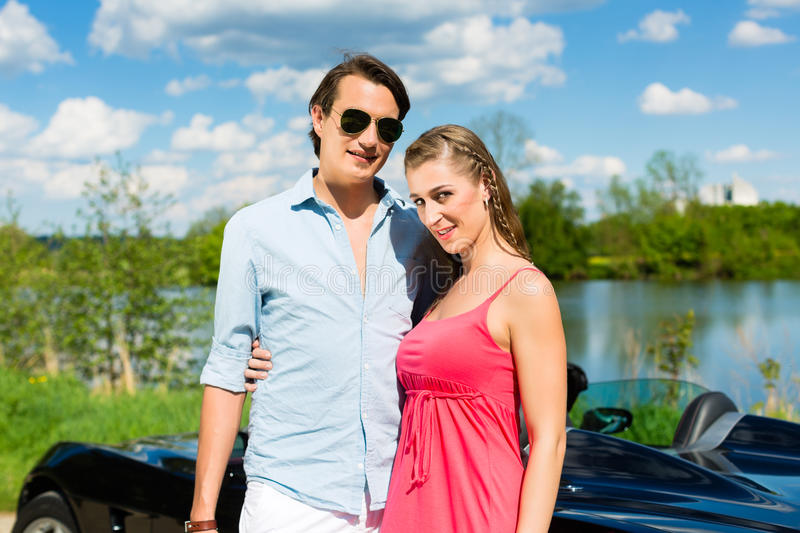 Download Young Couple With Cabriolet In Summer On Day Trip Stock Photo - Image: 25272318