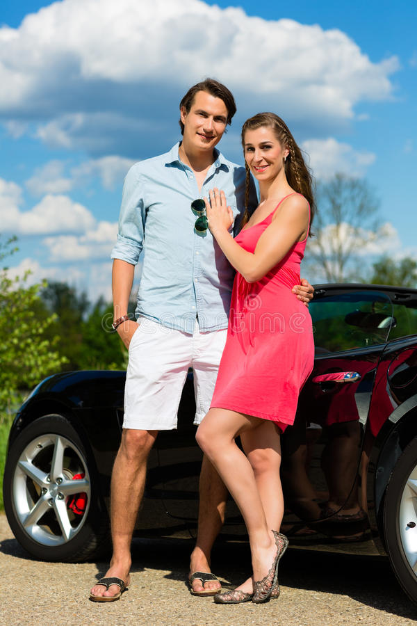Download Young Couple With Cabriolet In Summer On Day Trip Stock Image - Image: 25272377