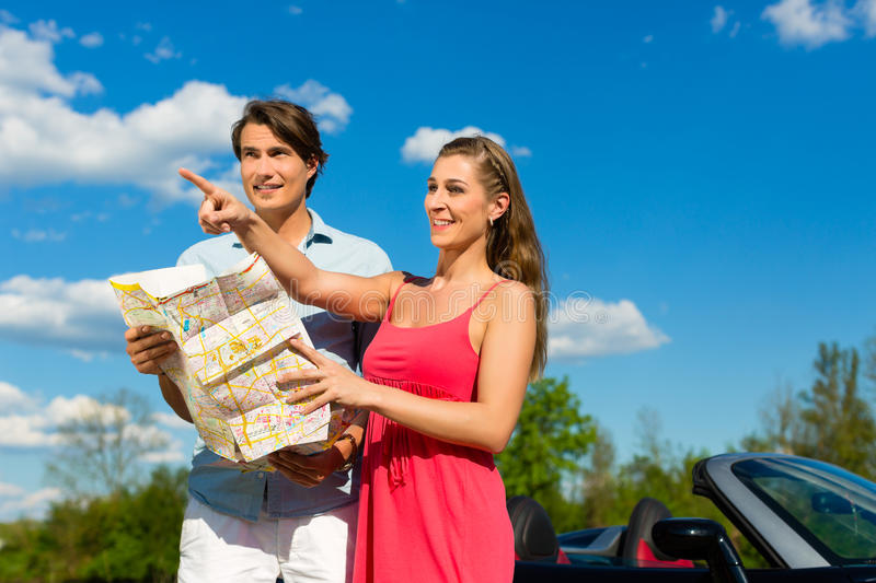 Download Young Couple With Cabriolet In Summer On Day Trip Stock Photo - Image: 28876114