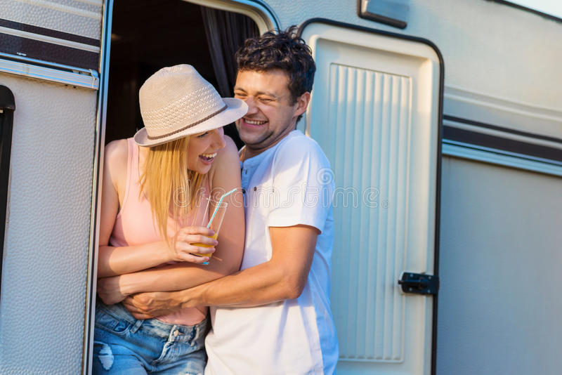 Young couple with a camper van royalty free stock photos