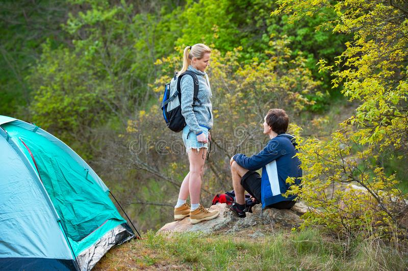 Young couple camping trip in forest at summer weekend. Travel, t. Ourism, hike and people concept royalty free stock images