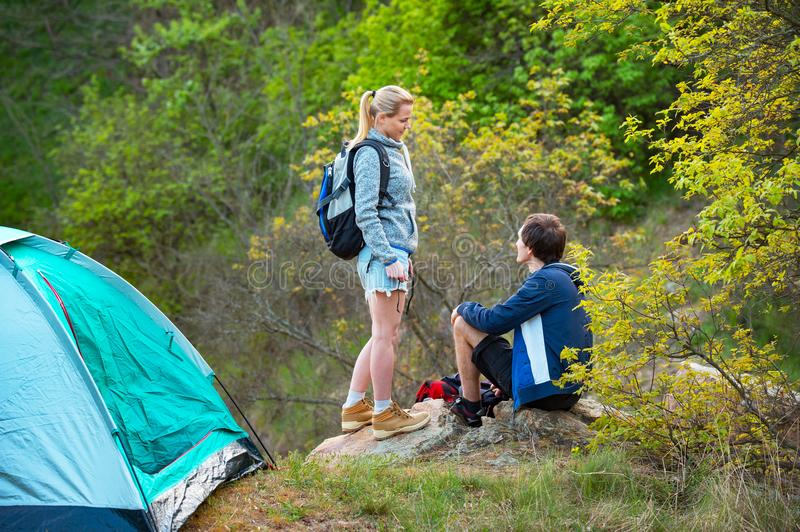Young couple camping trip in forest at summer weekend. Travel, t. Ourism, hike and people concept royalty free stock photography