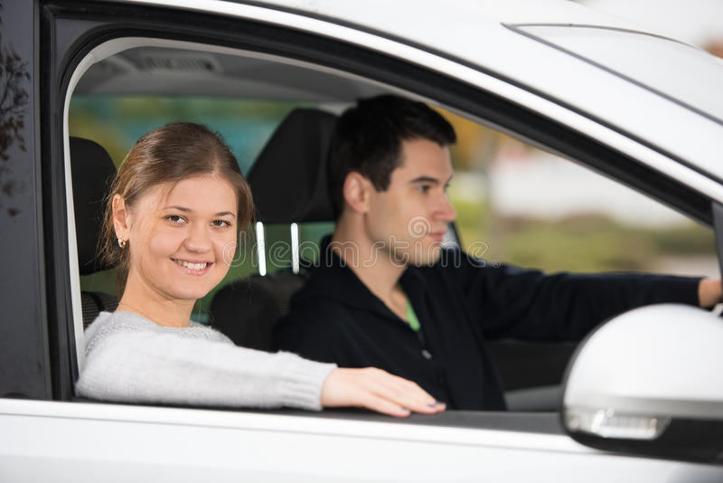 Young couple in a car royalty free stock photo