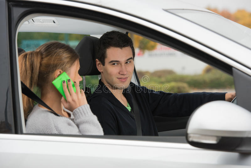 Young couple in a car royalty free stock images