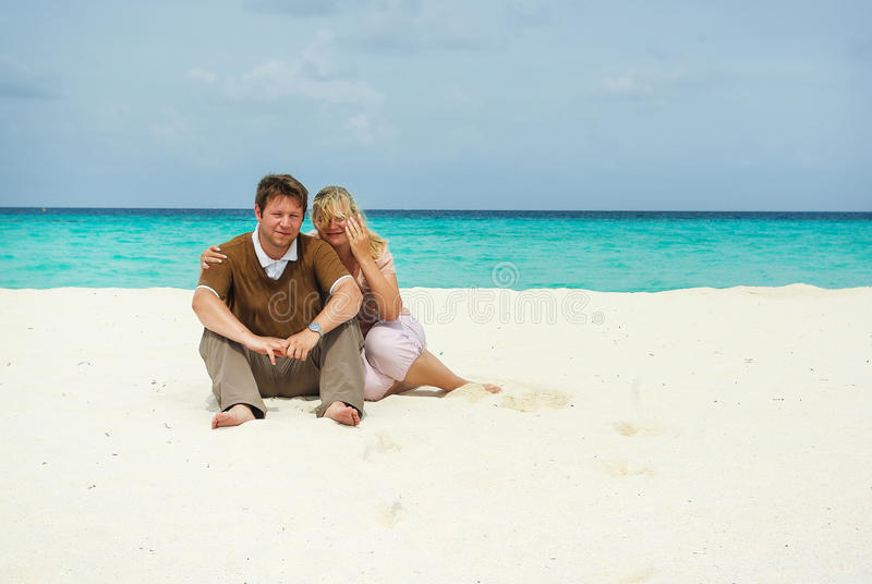Young couple on caribbean beach on honeymoon. Young couple in love on white sand beach Maldives stock photography