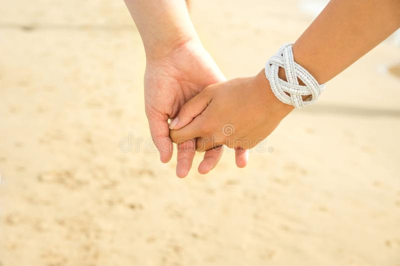 Young couple caucasian man and woman hold hands. Summer bright sunlight beach sand seaside background. Love family relationship royalty free stock image