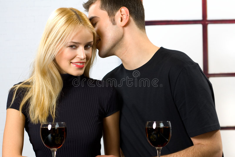 Young couple celebrating royalty free stock photography