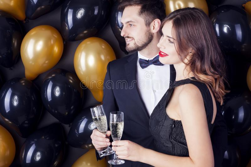 Young couple celebrating a Carnaval, New Year`s Eve. royalty free stock image