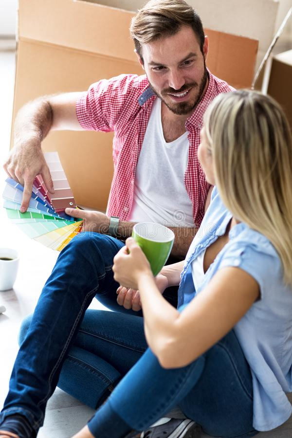 Young couple celebrating moving to new home royalty free stock photo