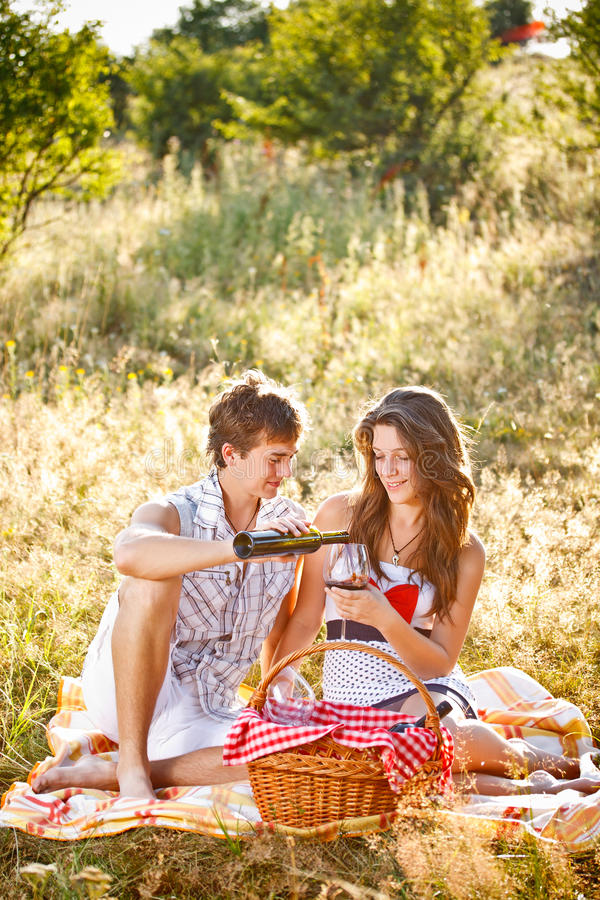 Young couple. Celebrating with wine at picnic