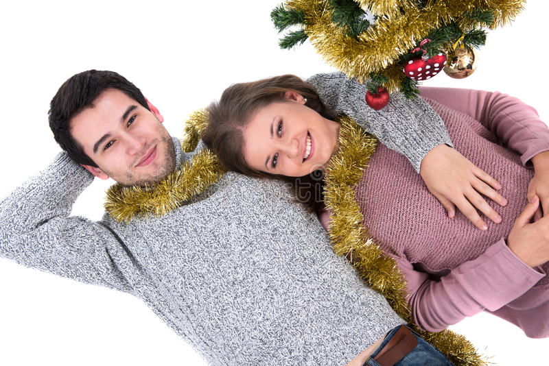 Young couple and Christmas tree royalty free stock photography