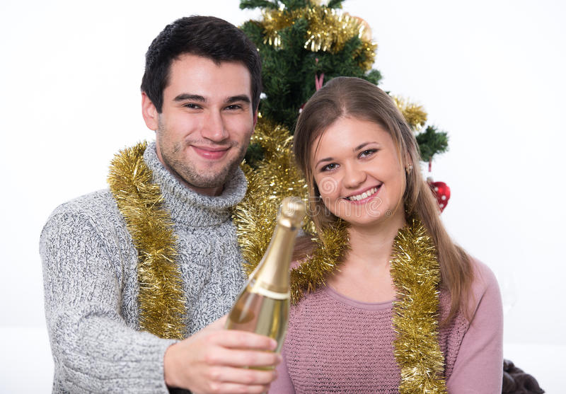 Young couple and Christmas tree royalty free stock photos