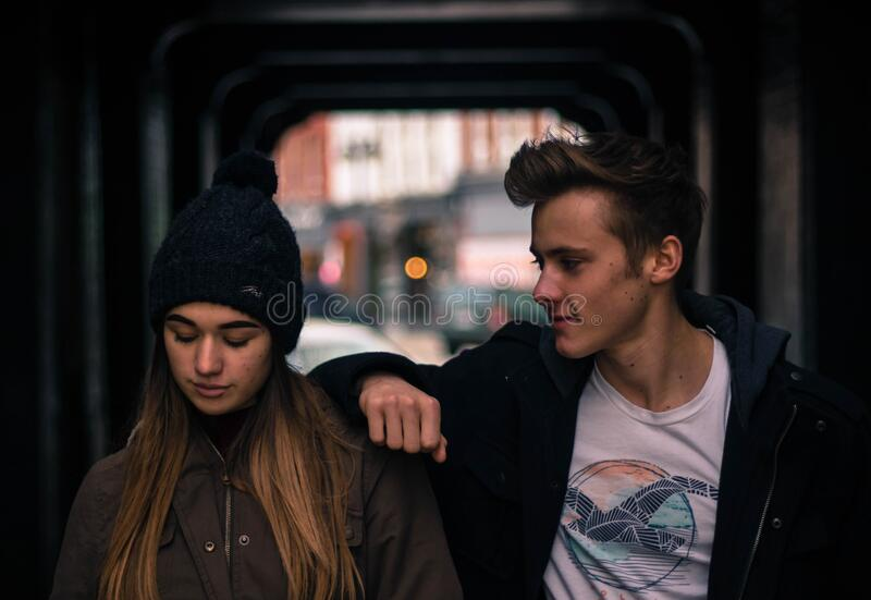 Young Couple in City at Night stock images