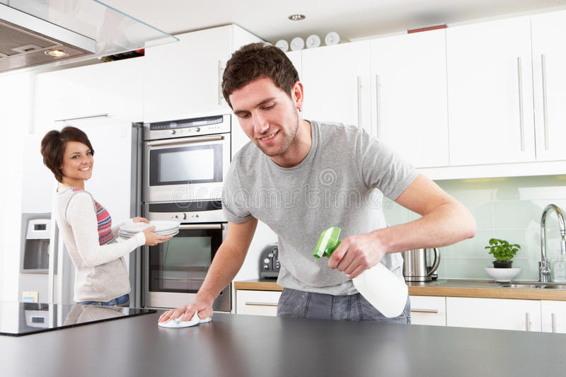 Young Couple Cleaning Modern Kitchen