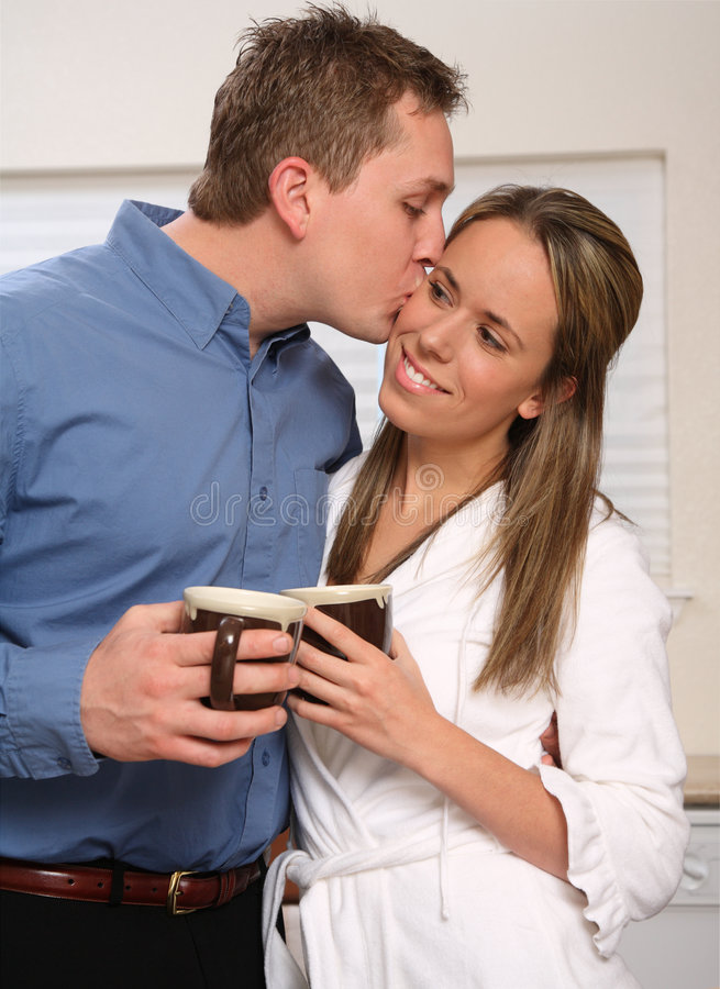 Download Young couple with coffee stock photo. Image of interacting - 4847614