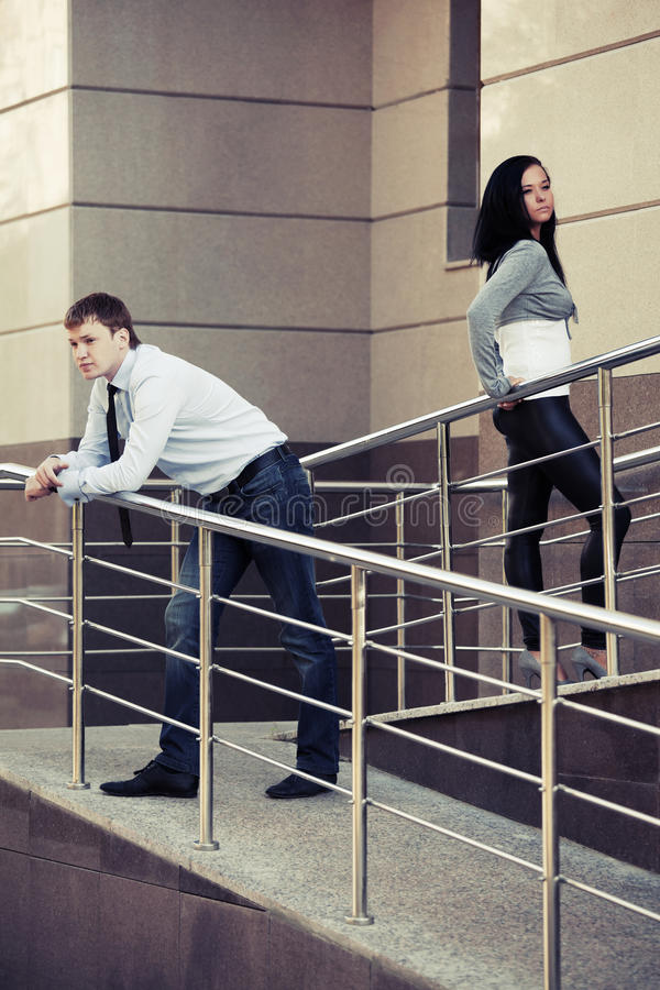 Young couple in conflict at office building. Young man and woman in conflict at office building royalty free stock photo