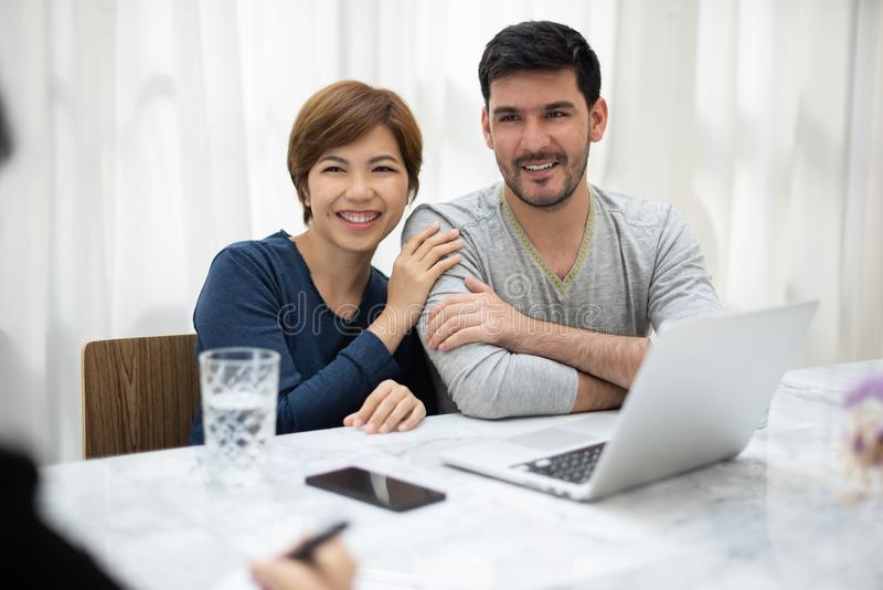 Young couple consulting with professional consultant stock image