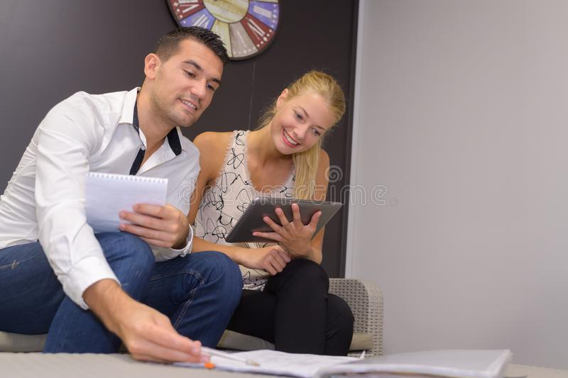 Young couple in consumer electronics retail store. Couple stock image