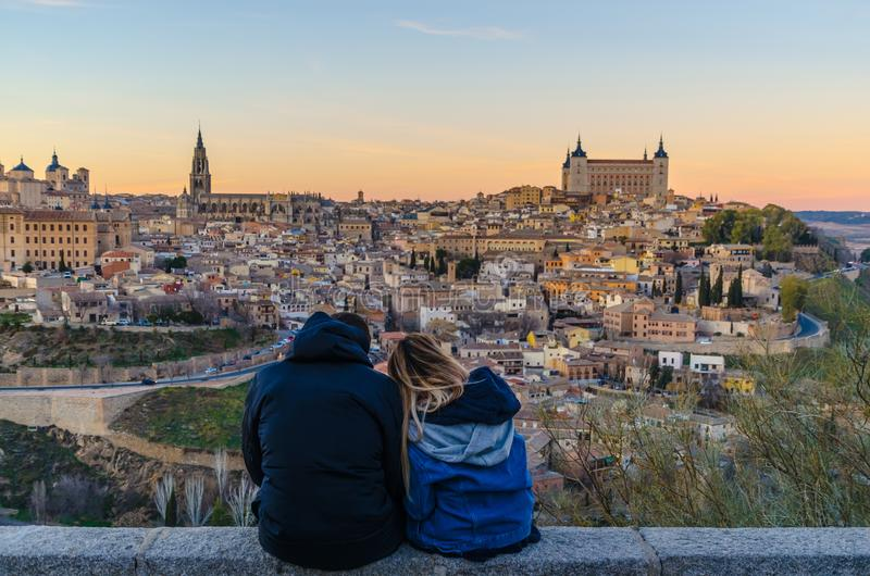 Young couple contemplating the city of Toledo at sunset royalty free stock photos