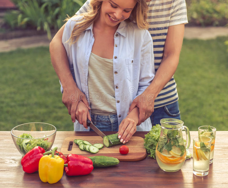 Young couple cooking stock image