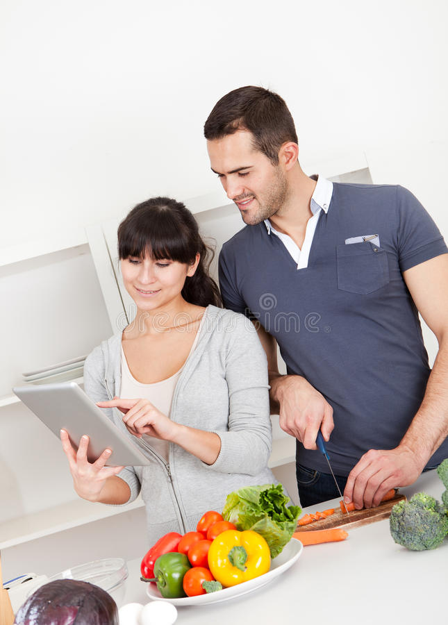 Young couple cooking at home royalty free stock photo image 24904715 - Young couple modern homes ...