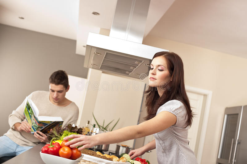 Download Young Couple Cooking In Kitchen Together Royalty Free Stock Photo - Image: 12982075